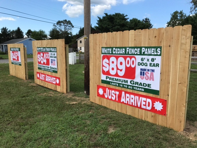White Cedar Fence Panels Display with Pricing Banners